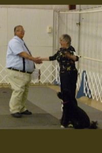 AKC Judge Larry Andrus tells Susan Forman that PWD Molly Brown qualified, got 3rd UD Leg and Utility Dog Title
